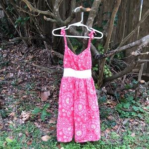 Girl's pink sundress.
